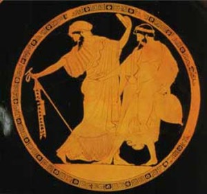 Greek drinking plate, showing either a woman dressed as a man or a man dressed as a woman, flirting with another man.
