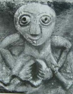 Sheela-na-gig (Celtic) carved on a corbel in the medieval church at Kilpeck, Herefordshire