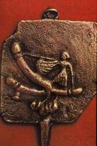 Bronze Amulet from Suffolk , England , woman wielding a triple phallus